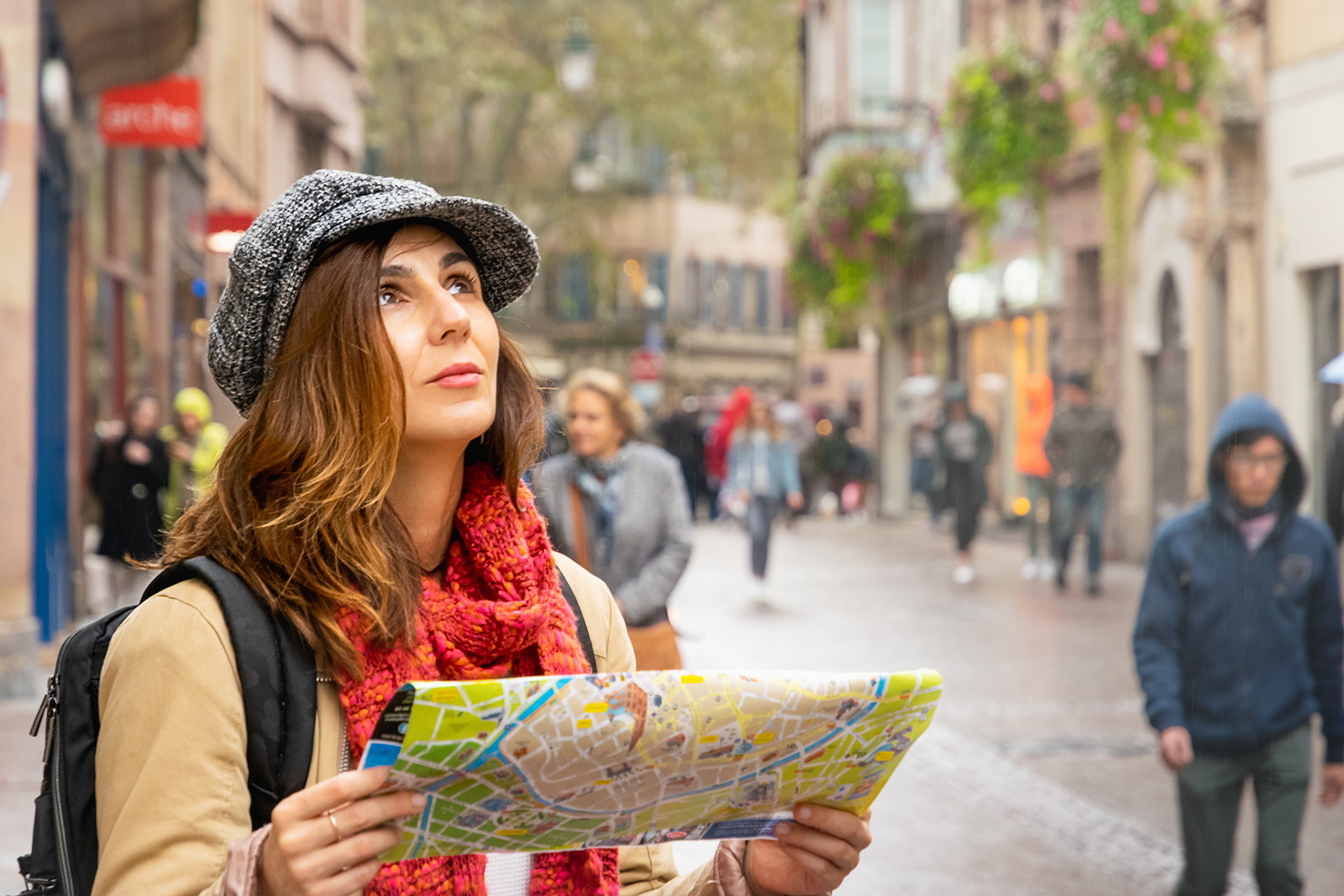 Woman traveling alone while holding a map.