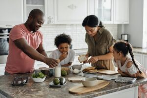 A family stands around the kitchen bench from Bed Bath n Table making breakfast